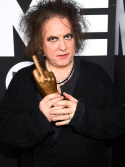 LONDON, ENGLAND - FEBRUARY 12: Robert Smith of The Cure poses withthe Awards for Best Festival Headliner during the NME Awards 2020 at O2 Academy Brixton on February 12, 2020 in London, England. (Photo by Dave J Hogan/Getty Images)